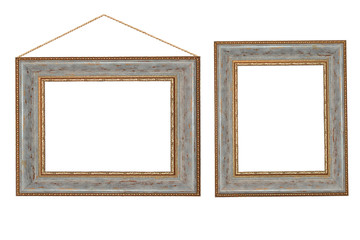 Two vintage baguettes in a gold frame on a white isolated background. A wooden frame with a picture.