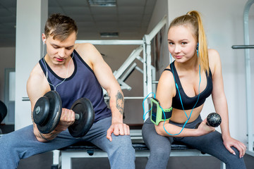 Man and a girl at a gym