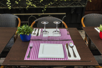 Table with glasses, plates and cutlery in Brussels, Belgium
