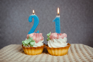 Happy 21 birthday - cakes and burning blue numbers candles
