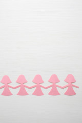 pink paper doll chain