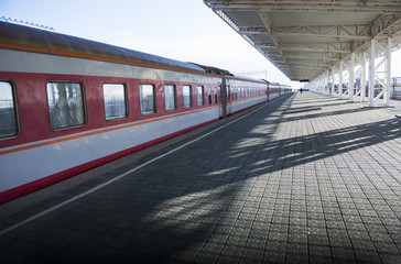 Platform at railway station in sunlight of dawn