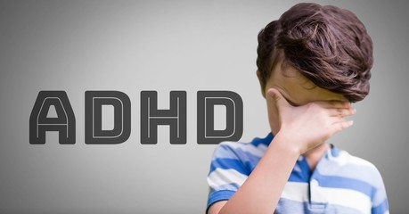 Boy against grey background with ADHD text
