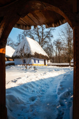 Fairytale cottage in winter at the Village Museum in Bucharest, Romania.