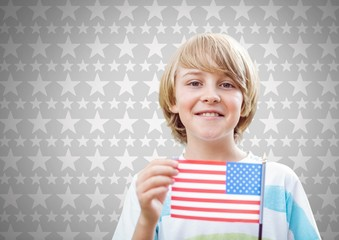 Boy against grey background with american flag and stars