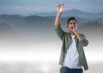 Man shouting in mountains