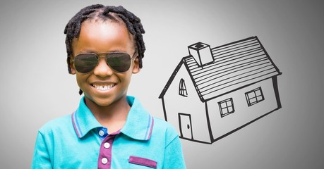 Boy against grey background with sunglasses and house