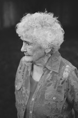 Monochrome portrait of old - elderly - lady staring outside
