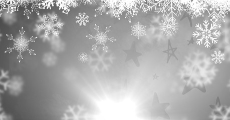 Grey background with snowflakes falling