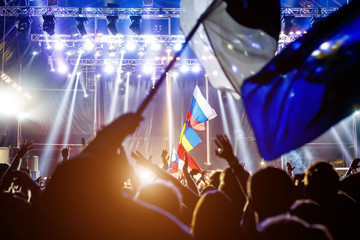 Russian flag at the concert, opposite the light from the stage.