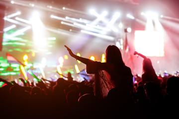 Girl cheering at rock festival