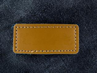 label on old black leather background