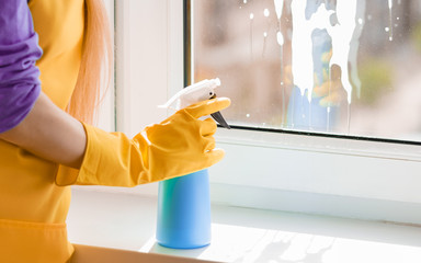 Woman hand cleaning window