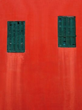 green windows on a red wall background