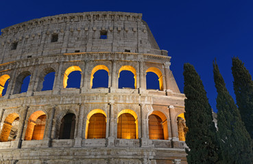 The Colosseum at night, a place where gladiators fought as well as being a venue for public entertainment, Rome Italy
