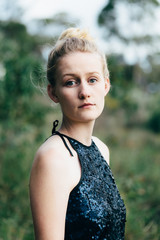 Portarit of teenage girl outdoors wearing a sequinned party dress