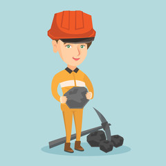 Caucasian female miner in hard hat holding a piece of coal in hands. Young smiling miner in workwear standing near a pickaxe and coal. Vector cartoon illustration. Square layout.