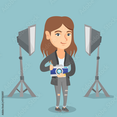 Young Caucasian Photographer Holding A Camera In Photo Studio Using Professional