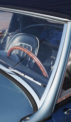 Wooden steering wheel in a classic car