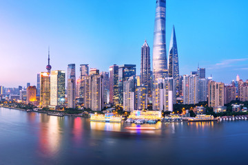 Aluminium Prints City building modern buildings near water at twilight