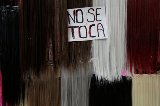 "Sign reading ""Don't touch"" is displayed over clip-in hair extensions at a boutique in Ciudad Juarez"