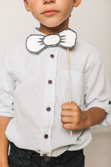 Portrait of little boy with diy bow tie.
