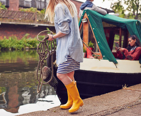 Girl mooring house boat