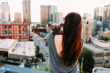 Girl holding french bulldog puppy