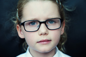 Serious young girl with glasses