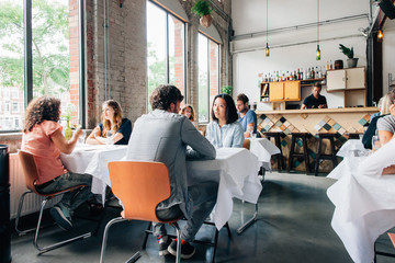 Young People Chatting in Modern Restaurant