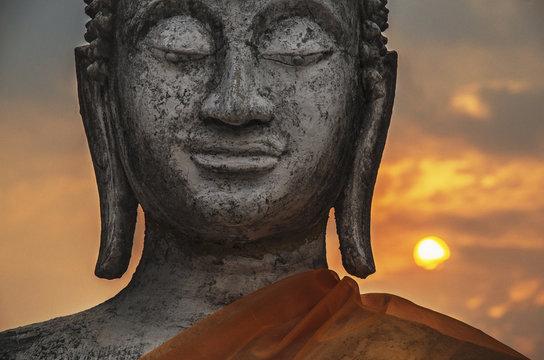 Carved stone Buddha statue; wat/temple complex in old Siam kingdom, Ayutthaya, Thailand