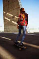 Blonde hot girl skating with a longboard around barcelona