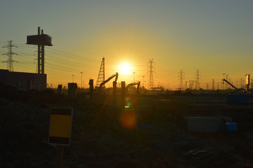 construction site and electrical Pole with Sunrise sky.