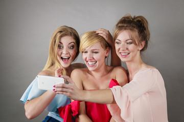 Fashionable women taking selfie