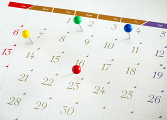 Upcoming events. Calendar with thumbtacks as a concept of events