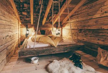 rustic sleepingroom in an old wooden alpine cabin