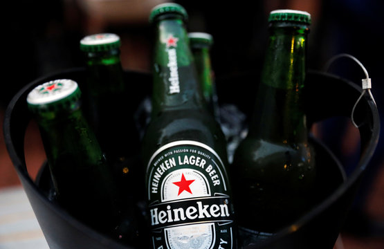 A photo illustration of a bucket with Heineken beers at a pub in Singapore