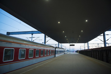 Platform at railway station in evening