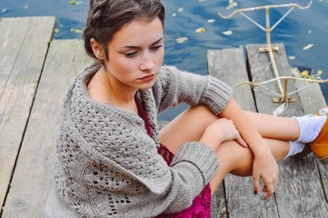 young woman on the dock