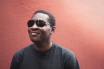 Black young man with sun glasses