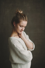 Cute young blonde girl in knit sweater