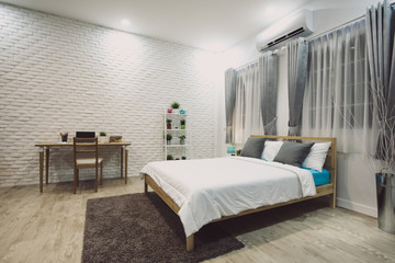 Stylish designed boy teenager's bedroom with white walls