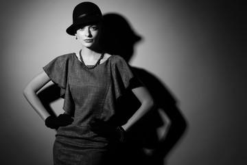 young elegant woman, retro fashion, hat, gloves, dress.