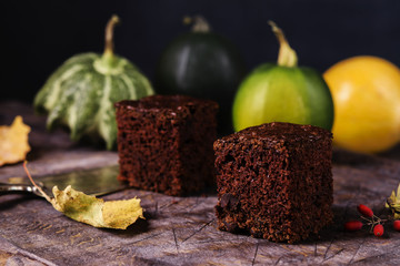 Chocolate zucchini brownie on a vintage wooden table. Proper nutrition. Healthy dessert. Selective focus