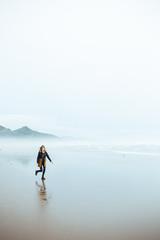 Girl Running On The Beach In Oregon