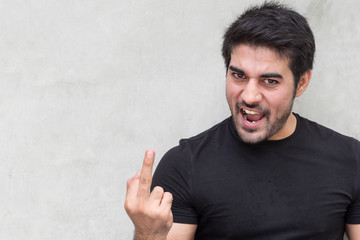 angry man giving middle finger
