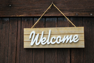 Welcome sign on wooden wall