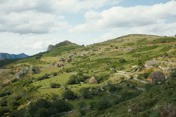 Landscape of abandoned shacks in the mountain