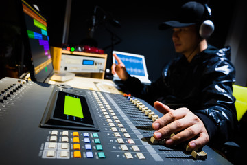 asian male sound engineer working in digital audio & video editing post production studio