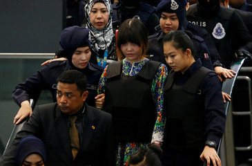 Vietnamese Doan Thi Huong, who is on trial for the killing of Kim Jong Nam, the estranged half-brother of North Korea's leader, is escorted as she revisits the Kuala Lumpur International Airport 2 in Sepang, Malaysia